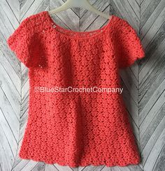 Crochet summer top for women with short sleeves, original design by Doris Chan. It is made from 100 % acrylic yarn therefor it is low maintenance and machine washable at cool wash. Made in a very fashionable Shrimp/Coral colour this top would look fabulous with jeans, leggins or skirts. It fits UK size 10-12 due to natural stretch of the material and lacy pattern. Please message me to enquire about postage outside UK mainland.