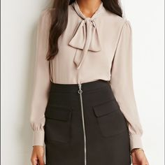 NWOT forever 21 top Super cute with a skirt and very formal, never worn because it doesn't fit me size small but would fit a sm/medium Forever 21 Tops Blouses