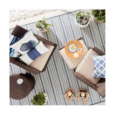 Make your outdoor living space feel as comfortable as indoors with the Outdoor Rug in Pattern Stripe Blue from Threshold. This outdoor throw rug can be rinsed clean with water.