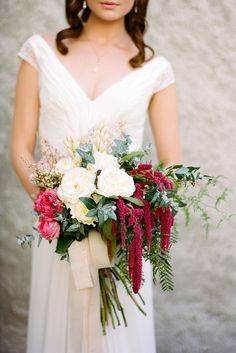 Romantic wedding bouquet with white roses and pink Amaranth | Adrian Tuazon | See more: http://theweddingplaybook.com/20-beautiful-wedding-bouquets-to-have-and-to-hold/