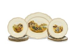 Royal Worcester porcelain plates, circa 1903 and 1909  painted with named fowl and poultry, signed C. Johnson, within shaped gadrooned gilt enriched borders; and a shaped oval serving dish en-suite, painted with three turkeys in a farm landscape, inscribed on reverse and with press number E4 but not marked, puce and blue printed marks to plates