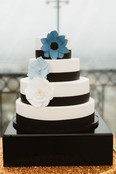 Whimsical Wedding Cake | See the wedding on SMP: http://www.StyleMePretty.com/2014/02/18/great-gatsby-inspired-wedding-at-the-london-west-hollywood/ Photography: Erin Hearts Court