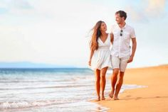 Couple walking during honeymoon vacation - Stock Photo ,