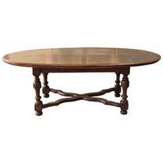 A Large Oval Walnut Italian Table, early 19th c.