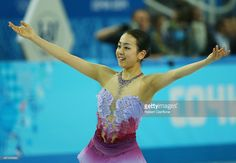Mao Asada of Japan competes in the Figure Skating Team Ladies Short Program during day one of the Sochi 2014 Winter Olympics at Iceberg Skating Palace on February 8, 2014 in Sochi, Russia.