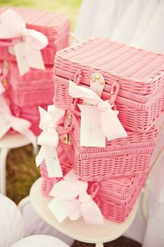 See these baskets at the thrift store all the time. Never thought to paint pink for storage..