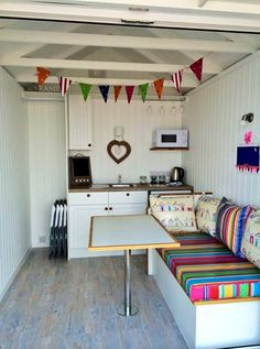 Interior inspiration Beach Huts - St Annes - just booked for summer 15 Beach Hut Shed, Beach Hut Decor, Pool Shed, Beach Huts, Playhouse Interior, Shed Interior, Interior Design Living Room, Playhouse Ideas, Wooden Playhouse