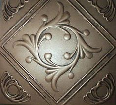 By: Dawn Monclova Ceiling Tile - Faux Like Tin - Anet Antique Copper Graphite Decorating with faux tin tiles can instan. Copper Ceiling Tiles, Styrofoam Ceiling Tiles, Copper Home Accessories, Decorative Accessories, Norman Reedus, Craftsman Bathroom, Tin Tiles, Adhesive Tiles, Antique Decor
