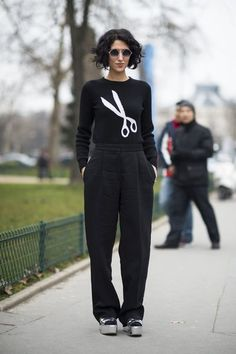Très Chic! The Best Street Style at Paris Fashion Week: Jewel tones and statement jewels gave this trouser and top look a high-wattage twist.  : A cheeky sweater, sunglasses, and platforms perked up black trousers.  Source: Le 21ème   Adam Katz Sinding