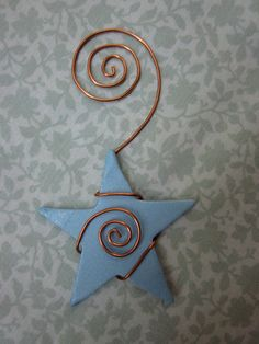 hand shaped recycled copper wire/clay star ornament. $9.00, via Etsy.