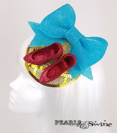 Wizard of Oz Ruby Slippers yellow brick road inspired fascinator Dorothy Gale, Dark Beauty Magazine, Ruby Slippers, Yellow Brick Road, Mad Hatters, Blue Bow, Gold Hands, Wizard Of Oz, Red Shoes