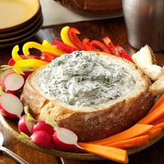Spinach Dip in a Bread Bowl Recipe from Taste of Home. -- Submitted by Janelle Lee of Appleton, Wisconsin.