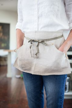 From the same folks who make our popular Grand Apron... With thoughtful details like unlacquered brass rivets and four waist-level compartments to keep all of your necessities close at hand, our apron