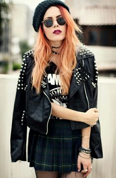 Luanna Perez grunge outfit.beanie, vintage sunglasses, leather jacket, band t-shirt and plaid skirt. Perfection