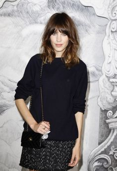 Alexa Chung... its the whole look thats got me. relaxed knit over a skirt. Who can look past the bangs and ombré