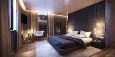 Mur tapissé derrière le lit