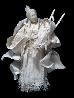 """'Wife and son of White Bull' is a one-of-a-kind original paper sculptures by Allen and Patty Eckman from the """"Warriors in the Wind"""" series"""