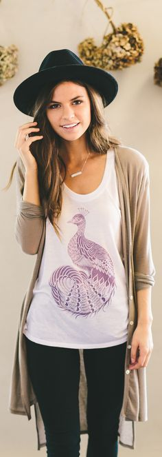 Peacocks symbolize transformation, beauty, and new beginnings. This cute shirt donates to help protect a mother and her children from domestic abuse.