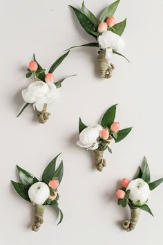 Lovely boutonnieres with ranunculus and hypericum berries