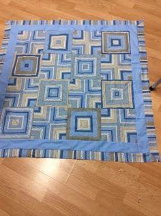 Quartered stripes quilt