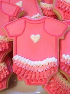Baby shower onesie cookies by Sara Belle's Bakery.