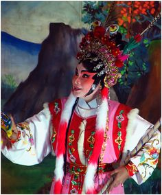 """The Ngew was born from the traditional Chinese Opera, which came into Thailand with Chinese immigrants. The """"players"""" are always decked out in beautifully decorated costumes set against highly colourful, very well-lit backdrops. A live band, out of sight just offstage, provides music performed on traditional Chinese instruments."""