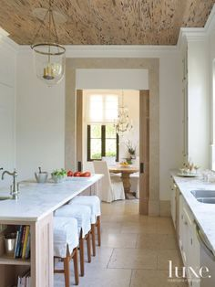 Contemporary White Kitchen with Pecky Cypress Ceiling