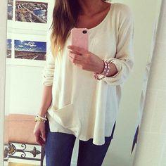 Sweater, skinnies and jewelry.