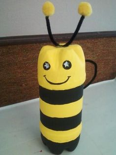 Bumble Bee made out of Pop bottles...  1. take 2 plastic pop bottles,, Cut top off of 1 & bottom of of other  2. glue bottom on to bottle that you cut top off of.  3. now paint