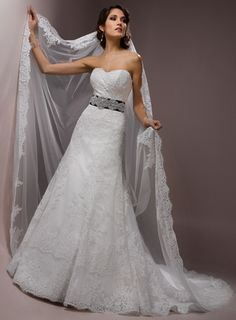 Maggie Sottero's Presca. Loving the A-lines and waist embellishments