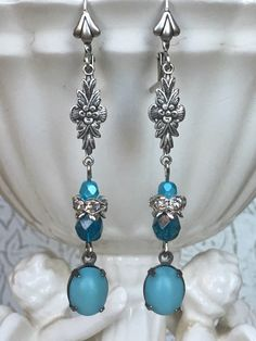 A personal favorite from my Etsy shop https://www.etsy.com/listing/513090315/teal-aqua-silver-dangle-drop-earrings