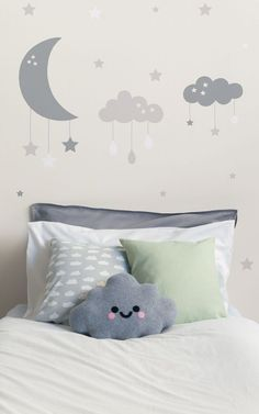 If you're looking to create a charming and calming space in your baby's nursery, our unique Baby Clouds and Moon Wall Mural design is perfect. Featuring large clouds and a crescent moon, with little stars and raindrops hanging from them. This adorable mural has a soft beige and taupe colour palette which is calming and neutral, meaning you can pair it with any furniture and keep it looking stylish. #wallpaper #murals #interiordesign #homedecor #nursery #genderneutral #princeandprincess