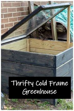 Learn how to make this basic cold frame that acts like a greenhouse to hold transplants and keep them protected while letting in light. #minigreenhouse #coldframe #DIYgardening