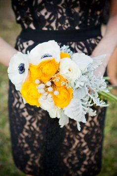 A unique pairing of the marigold ranunculuses, anemones, and dusty miller. #weddingbouquets Julie Rohde Designs