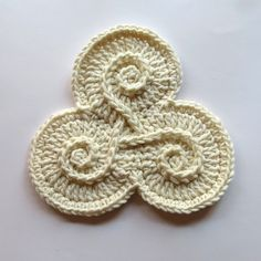 Gorgeous triskele. Part of a monochromatic freeform vest that incorporates many Celtic and Pagan symbols. Her steam has many amazing crochet (and knit) pieces.
