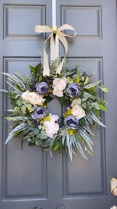 Gorgeous blue and cream peonies are paired with variegated greenery and blueberries making this beautiful wreath perfect for Spring and summer. Diy Spring Wreath, Summer Door Wreaths, Easter Wreaths, Diy Wreath, Christmas Wreaths, Flower Wreaths, Yarn Wreaths, Tulle Wreath, Burlap Wreaths