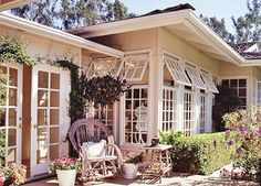 Manually operated awning windows provide an escape route for sun-warmed air while offering some protection against sudden summer showers. Deep roof overhangs shade the glass during the hottest part of the day.