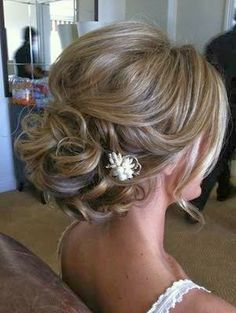 Wedding Updos: Curls and Flower Hair Accessories