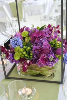 Purple dominated table setting with lime and blue accents