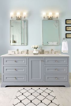 master bathroom with two sinks, vanity, grey cabinetry