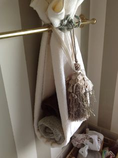 Hang towels in the bathroom. Cute and different