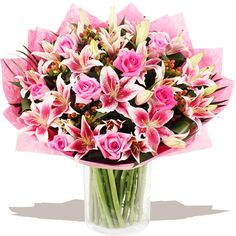 Deluxe Pink Lily & Rose Hand-tied A deluxe, extra large hand-tied bouquet of pink large head Roses styled in the hand with with glorious sprays of pink Oriental Lilies, plump Hypericum berries and finished with tropical leaves. Gift Bouquet, Hand Tied Bouquet, Pink Rose Bouquet, Oriental Lily, Flowers Delivered, Pink Lily, Love Flowers, Wedding Bouquets, Wedding Flowers