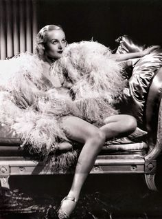 Lady of Feathers — The feather influence is reported to have hit Hollywood along with the rest of the world as a fashion mode. And here Carole Lombard, Paramount screen actress, goes to extremes to show how a complete feather outfit will look. Old Hollywood Glamour, Hollywood Fashion, Golden Age Of Hollywood, Vintage Hollywood, Hollywood Stars, Hollywood Actresses, Classic Hollywood, Carole Lombard, George Hurrell
