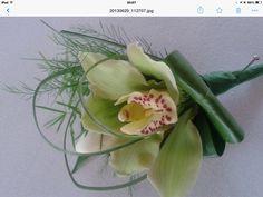 Mans Orchid buttonhole ladies boutonnière suitable for men and ladies