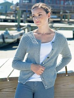 Knit in pieces and seamed, this cardigan features a gansey-inspired textured stitch pattern at the shoulders.