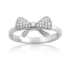La Preciosa Sterling Silver Small CZ Bow Ring (£21) ❤ liked on Polyvore featuring jewelry, rings, white, cubic zirconia rings, cz rings, cz band ring, round cut rings and long rings