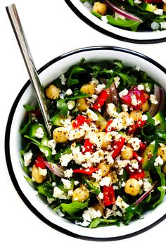 LOVE this easy Mediterranean salad! Its full of all of my favorite Greek salad ingredients, plus lots of arugula and chickpeas, and tossed with a zippy red wine vinaigrette. Serve it as a side salad or make a meal out of it! | gimmesomeoven.com #mediterranean #salad #healthy #greek #vegetarian #mealprep #dinner #side