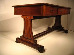 Fabulous Antique Mahogany Leather Top Writing Desk in perfect condition. Having three full length drawers to one side, faux drawers to the opposite side under a full length and leather covered writing surface resting on a stretcher base with carved sides ending in bun feet. This desk is in a wonderful state of preservation. Likely English of the William IV period c.1830. Price $6,500