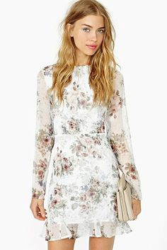 $100-$200: The closest you can get to white at a wedding? A large floral print like this long-sleeved style ($185) from Nasty Gal.