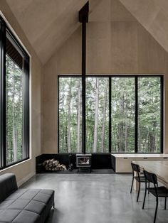 Polished concrete floor, black features and pale wood